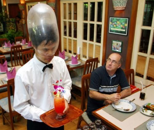 Cabbages and Condoms in Thailand - Waiter at Cabbages and Condoms