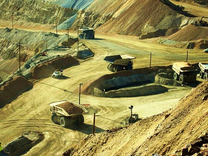 The Bingham Canyon Mine - Mine haul trucks moving ore in Bingham Canyon copper mine