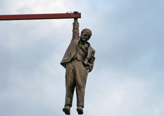 The Statue of a Man hanging by one hand - Sigmund Freud