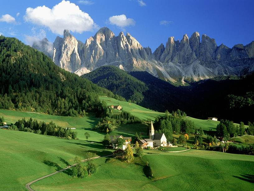 Italy  - Outlines of the mountains in a greenish landscape