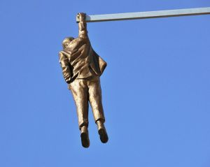 The Statue of a Man hanging by one hand